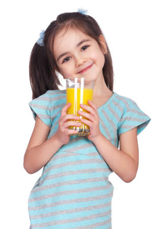 Portrait of happy little girl drinking orange juice Stock Photo