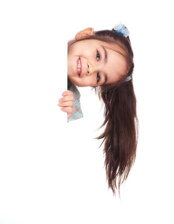 Smiling little girl holding empty white board Stock Photo - 9104125