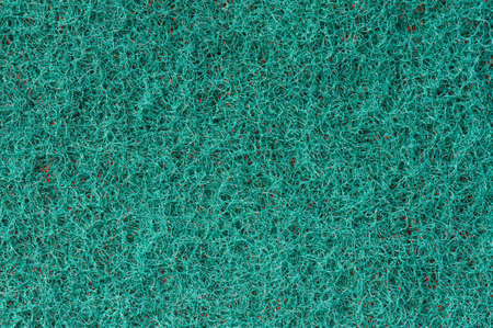 Close-up of a green cleaning sponge surface as a backdrop photo