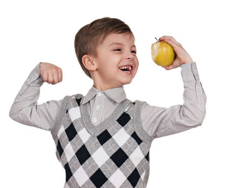 strongman: Little boy with apple. Isolated on white background.