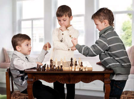 triplet: playing chess game in room