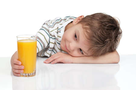 one little boy: Little boy having a glass of refreshing oranges juice - isolated on white