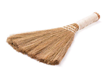 Close up of new broom on white background. photo