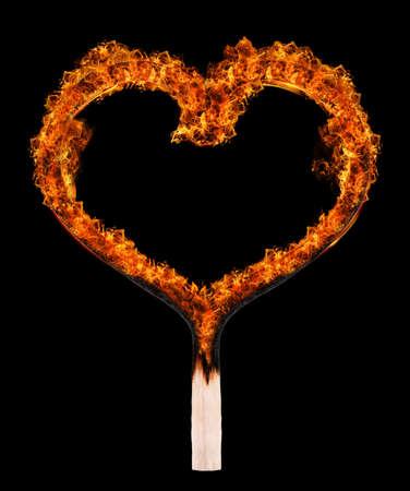 Burned match in shape of heart on black background photo