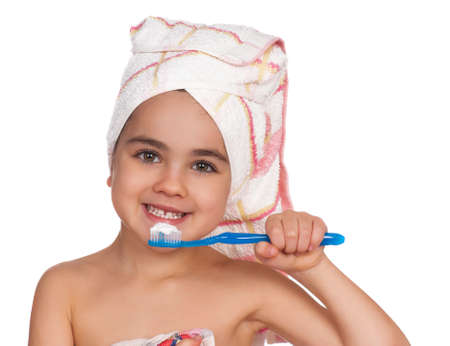 Happy little girl with toothbrush. Isolated on white background. photo