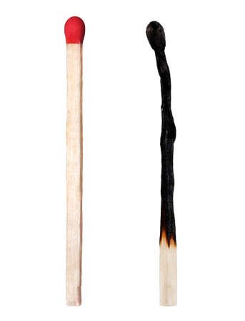 consumable: Close-up of a burnt match and a whole red match isolated on a white background