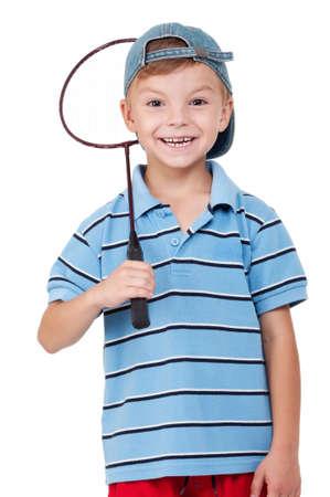 Little boy playing badminton - isolated on white background photo
