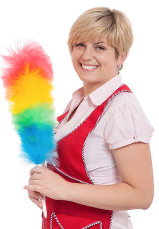 Happy young housewife holding duster - isolated on white background photo