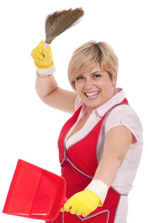 Happy young housewife holding dustpan and broom - isolated on white background photo
