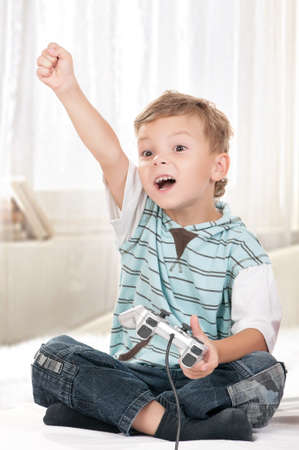 Happy child playing a video game photo