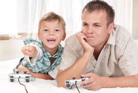 Happy family playing a video game photo