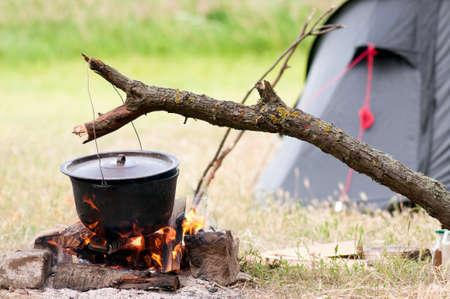 log fire: Pot on fire