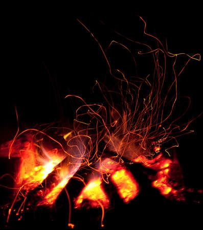kindling: Bright red yellow fire flames in dark night