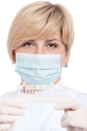 Portrait of female dentist - isolated over a white background photo