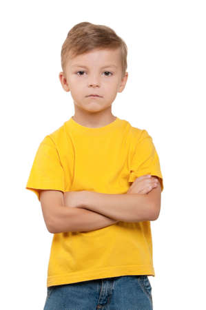 Portrait of funny little boy over white background photo