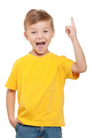 Cheerful little boy pointing up over white background Stock Photo - 10387004