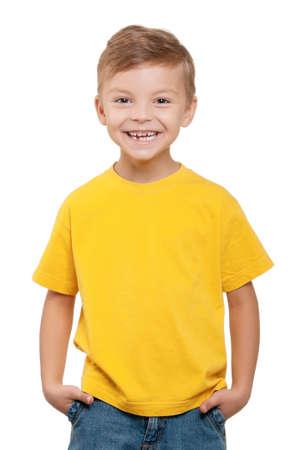 Portrait of happy little boy over white background photo