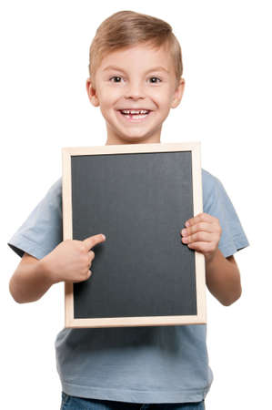 Portrait of a little boy holding a blackboard over white background Stock Photo - 10440775