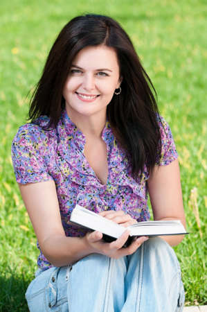 Portrait of a young female student with books at the campus Stock Photo - 10440805