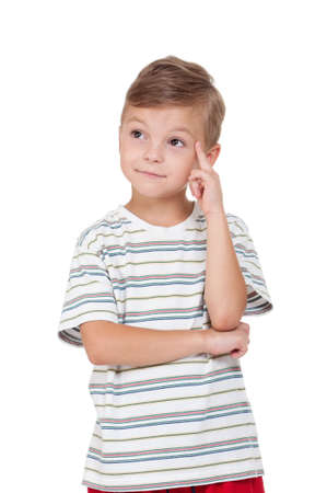 schoolkid: Portrait of emotionally kid. Funny little boy isolated on white background. Beautiful caucasian model. Stock Photo
