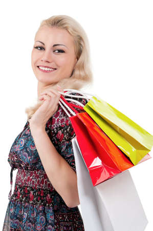 Portrait of a young woman holding a shopping bags over white background Stock Photo - 10440786