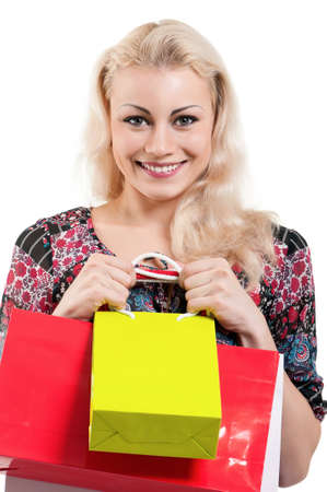 Portrait of a young woman holding a shopping bags over white background Stock Photo - 10440794