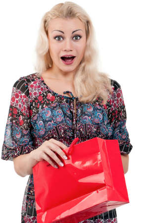 Portrait of a young woman holding a shopping bags over white background Stock Photo - 10440806