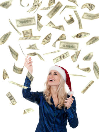 Smiling christmas girl catching falling dollars banknotes wearing Santa hat. Isolated on white background. photo