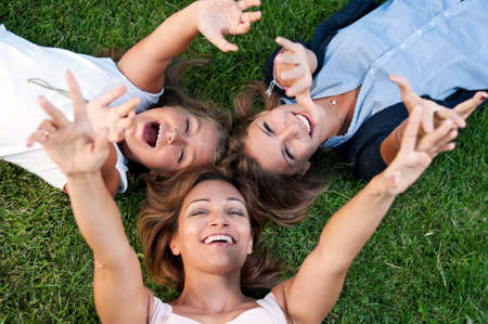 Happy mother with her daughters in park outdoors photo