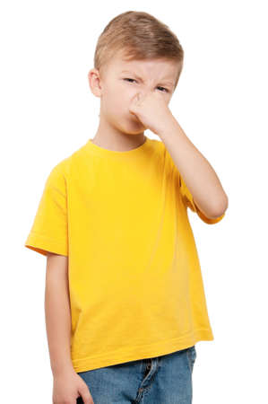 stench: Portrait of little boy covering nose with hand on white background Stock Photo