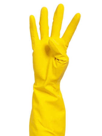 scrubbing up: Woman hand in yellow glove making sign - isolated on white background Stock Photo