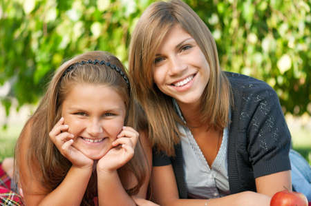 Portrait of happy two sisters in park outdoors Stock Photo - 10776464