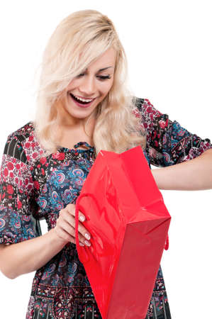 Portrait of a young woman holding a shopping bags over white background Stock Photo - 10776567