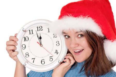 Portrait of a girl in Santa hat with clock on white background photo
