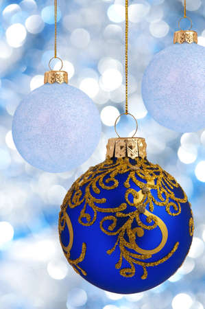 three wishes: Christmas balls on abstract blue lights as background