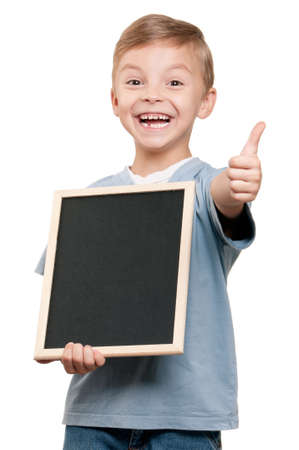 kid friendly: Portrait of a little boy holding a blackboard over white background