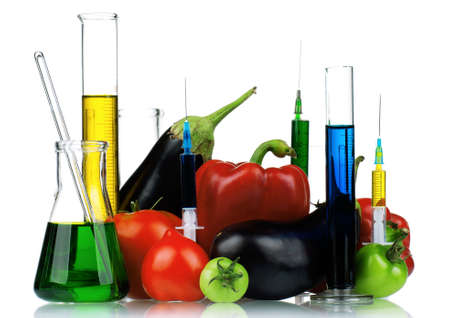 genetically: Genetically modified organism - vegetables with syringes and laboratory glassware on white background