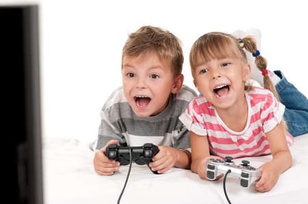 controller: Happy children - girl and boy playing a video game