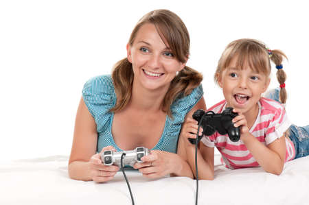videogame: Happy family - mother and child playing a video game Stock Photo