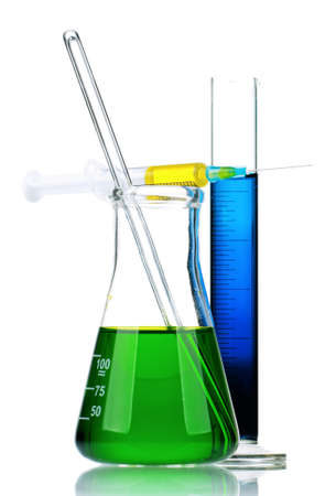 analytical chemistry: Laboratory glassware with colorful liquids and syringes on white background
