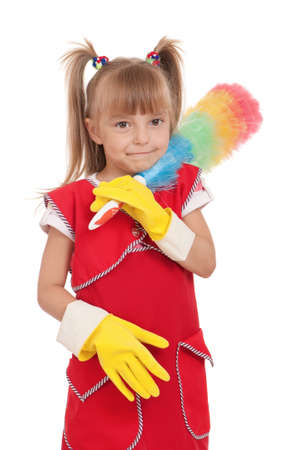 Portrait of beautiful little housewife with colorful duster isolated on white background. photo
