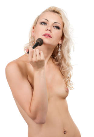 Portrait of young beautiful woman with makeup brushes over white background photo