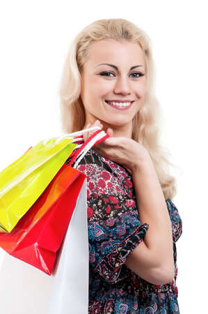 Portrait of a young woman holding a shopping bags over white background photo