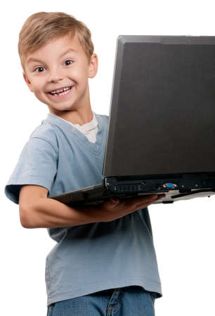 Portrait of funny little boy with notebook over white background photo