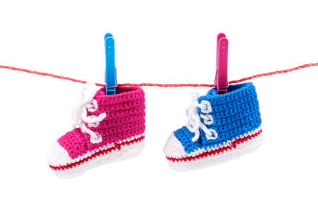bootees: Baby bootees on the clothesline on a white background