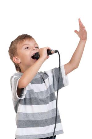 persona cantando: Ni�o con micr�fono - aisladas sobre fondo blanco Foto de archivo