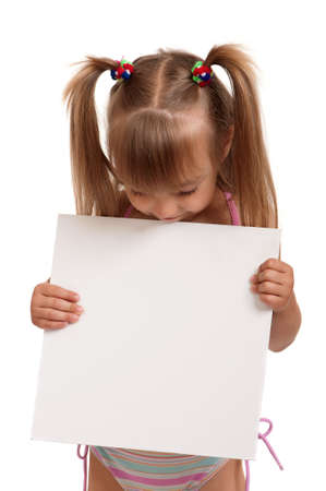 Little beautiful girl wearing pink swimsuit holding empty white board isolated on white background Stock Photo - 11153593