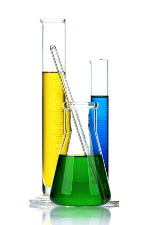 Laboratory glassware with colorful liquids on white background photo