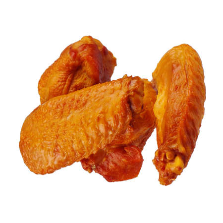 Delicious smoked chicken wings on a white background photo