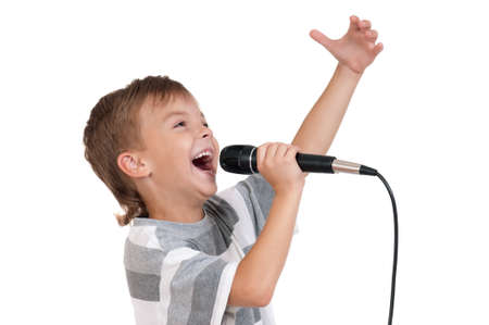 child singing: Little boy with microphone - isolated on white background Stock Photo